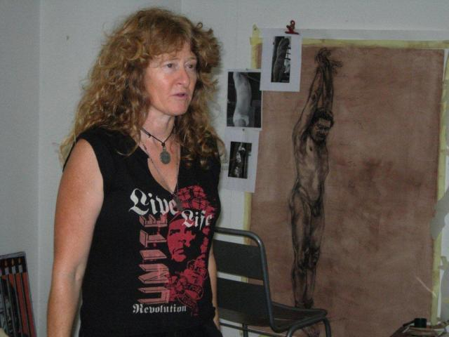 Diane Victor in her studio in August House, downtown Johannesburg, explaining how she has gone about creating Birth of a Nation Series: Marsyas: Detention, 2010, charcoal and sepia wash on paper, 140 x 95