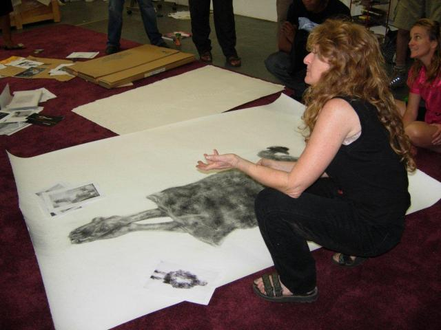 Diane Victor in her studio demonstrating the volatility of ash derived from burnt books used to create her dust drawings such as Transcend series III, 2010, 151 x 100 cm