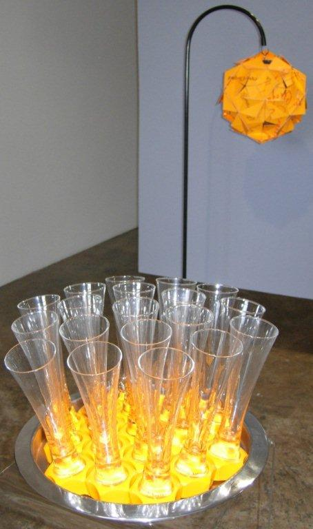 Christina Bryer's Pop & Toast in front of Tom Dixon's lamp (photograph MAMs)