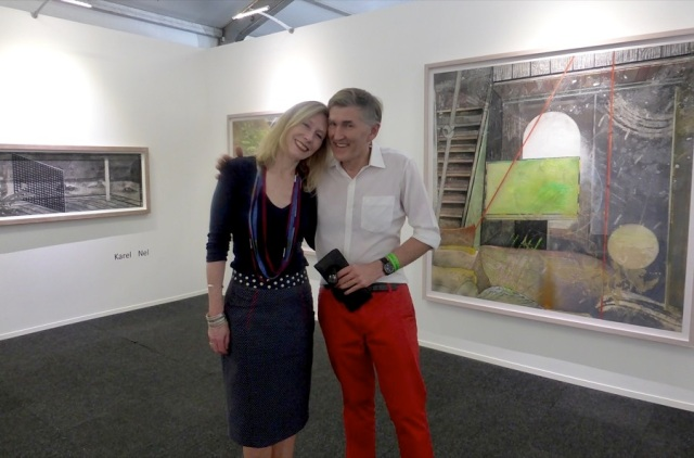 London based Art First's Clare Cooper and renowned South African artist, Karel Nel in front of his works at the 2015 Cape Town Art Fair.